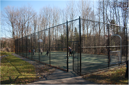 Fenced in basketball and ball hockey court