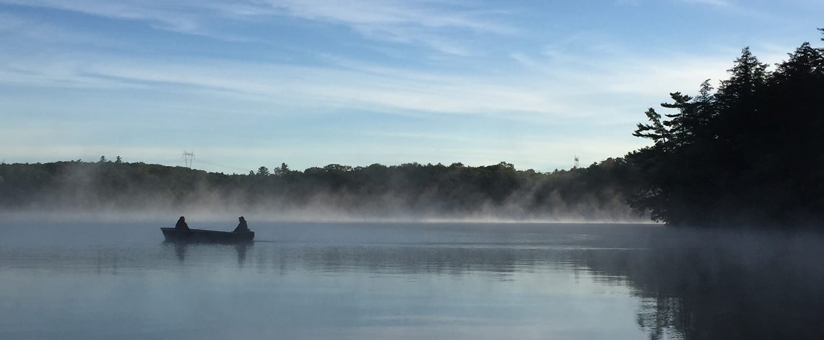 Boat with mist on lake