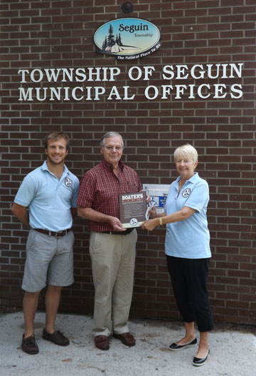 Mayor receiving plaque from Safe Quiet Lakes reps