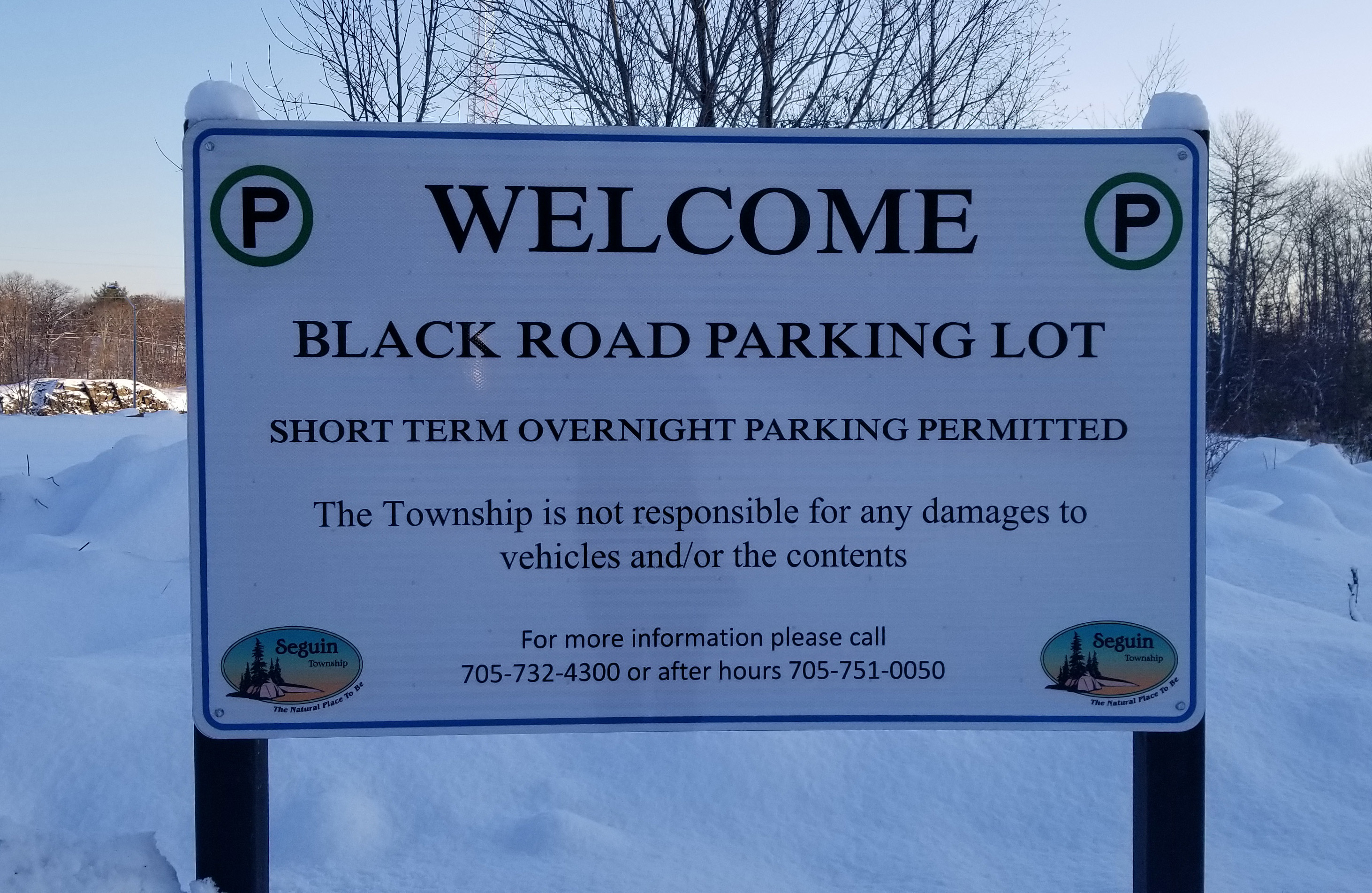 Sign about black road parking