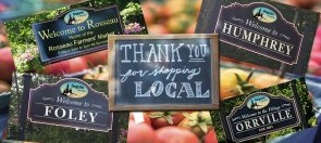 signs for community encouraging local shopping
