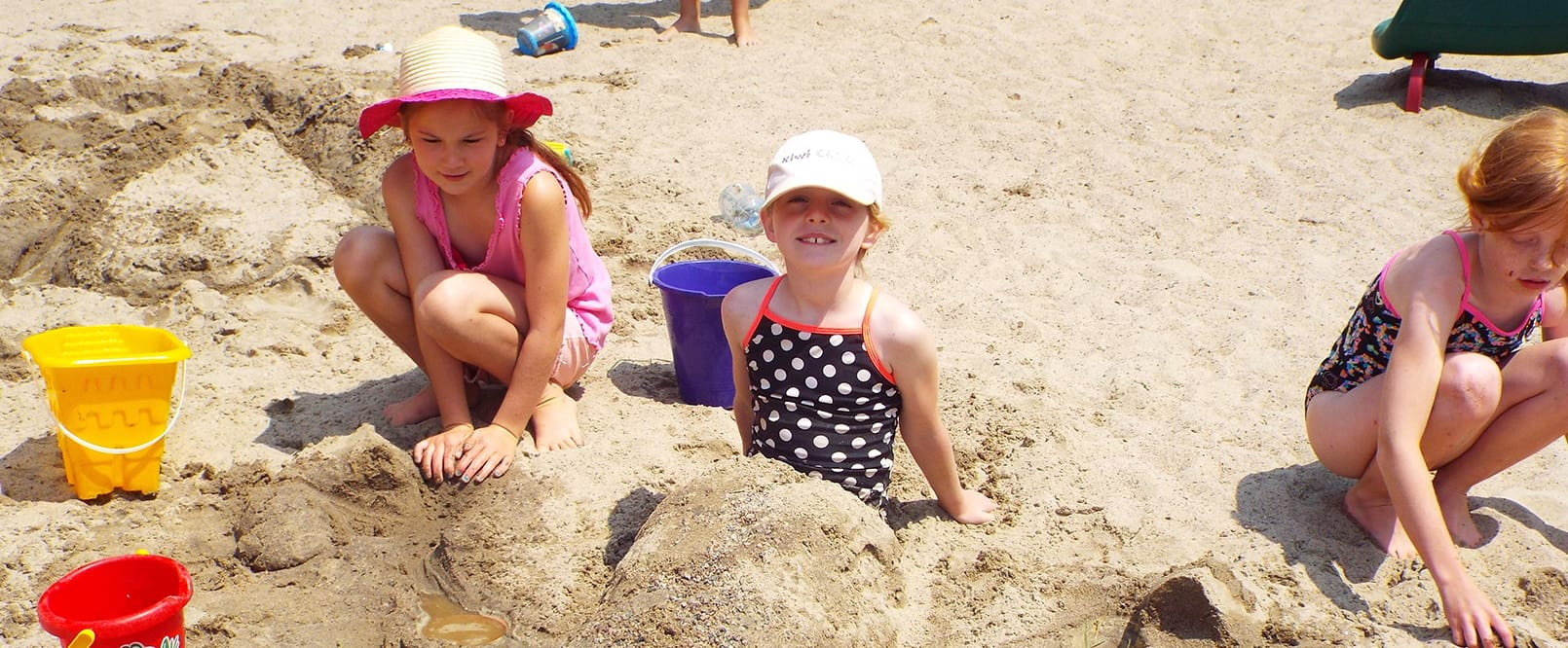 kids making sand castles at beach